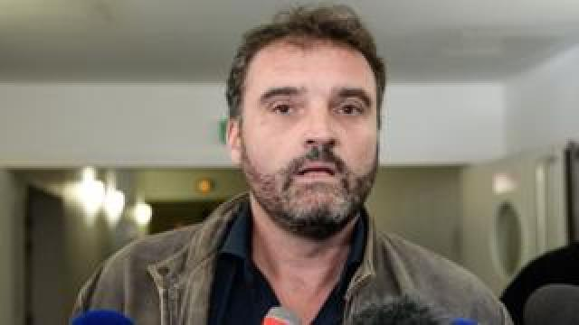 Frédéric Péchier talks to journalists