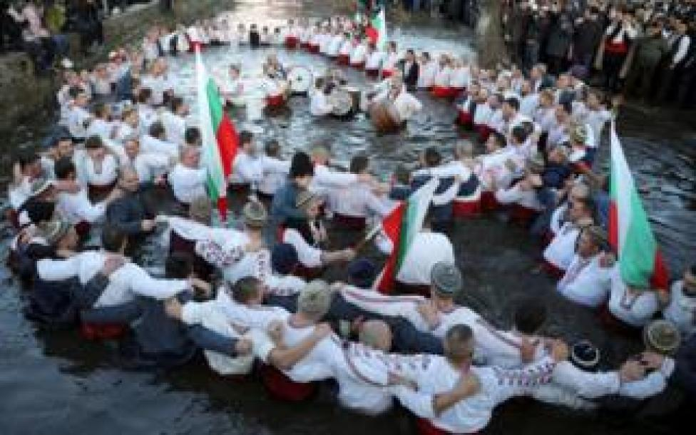 trump Men dance in the icy waters of Tundzha river during a celebration of Epiphany Day
