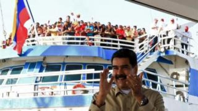 Handout photo released by the presidential press office showing President Nicolas Maduro applauding in the port of La Guaira, Venezuela on 2 August 2019