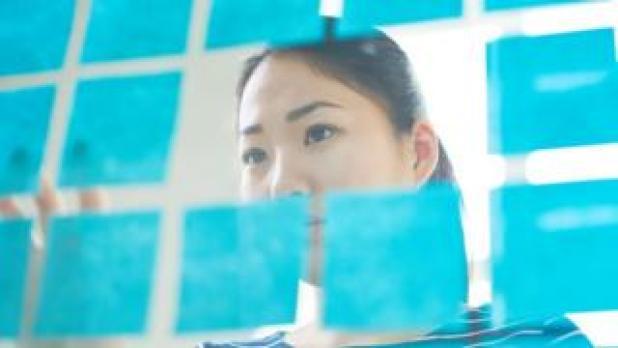 Woman peering at data