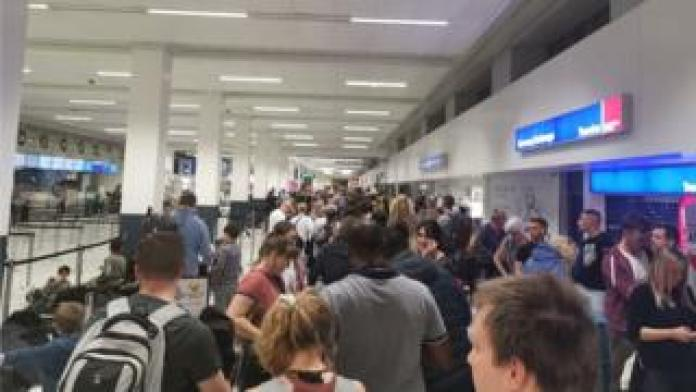 Queues at the easyJet desk at Manchester Airport