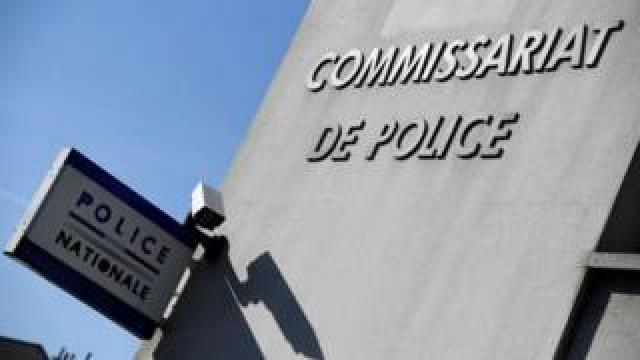 A police station sign in Paris