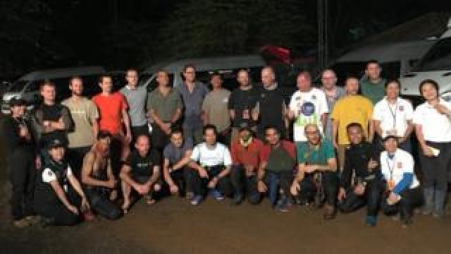 The cave rescue team celebrate