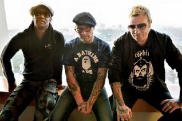 Liam Howlett (R), Keith Flint (C), and Maxim (L) posing prior to an interview in Tokyo, 2015