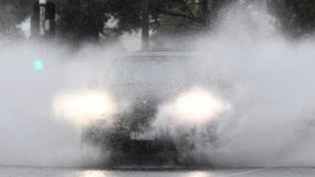 A car travels drives through heavy rain in Australia