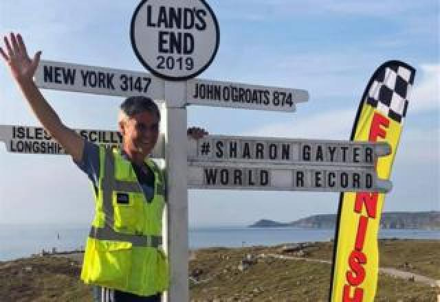 Sharon Gayter at the Land's End location sign