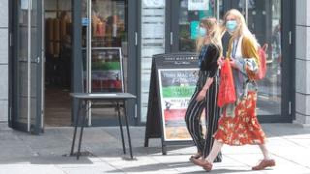 Residents walk in central in Aberdeen