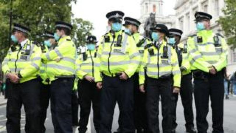 Police officers at an anti-lockdown protest in London