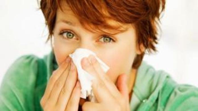 Diabetes Symptoms Woman blowing her nose
