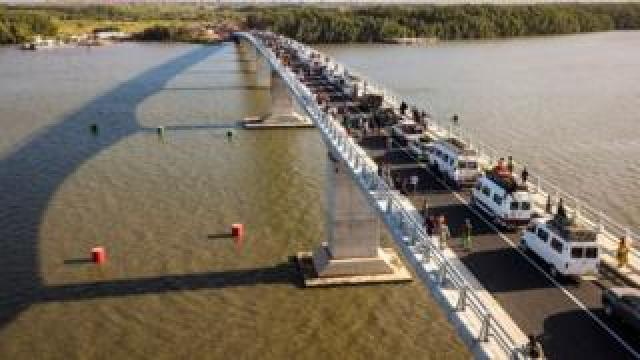 Aerial view of people crossing the Farafenni Bridge after its inauguration by Senegal's president and Gambia's President on 21 January 2019, in Farafenni