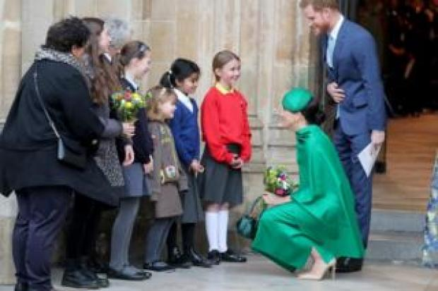 Duke and Duchess of Sussex meet children outside Westminster Abbey
