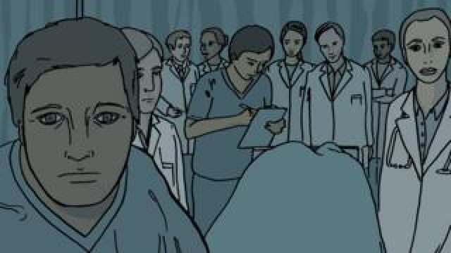 Doctors crowding round to see the tetanus patient