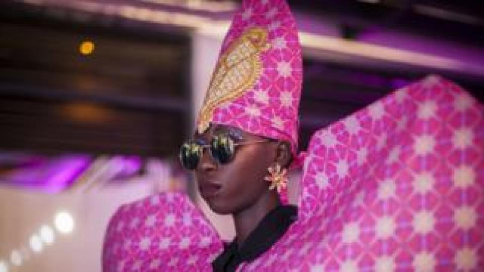 A model wearing a colourful pink design by fashion label Liputa Swagga during Dakar Fashion Week in Dakar, Senegal