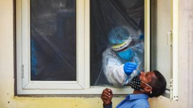 A health worker takes a swab sample for a coronavirus test in New Delhi, India - 9 September 2020