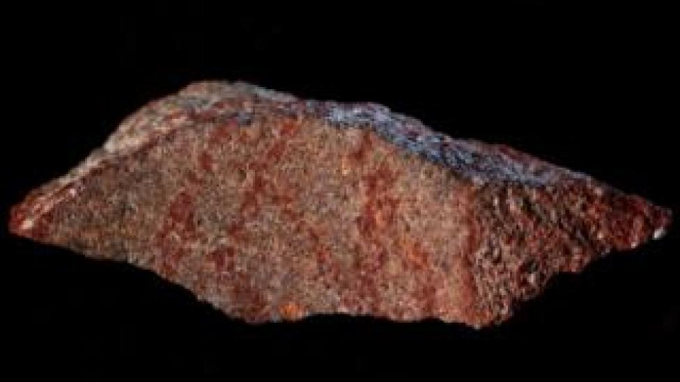 NEWS The oldest-known drawing, painted in ochre pigment on a small stone