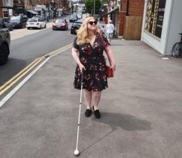 Dr Amy Kavanagh walking along the street