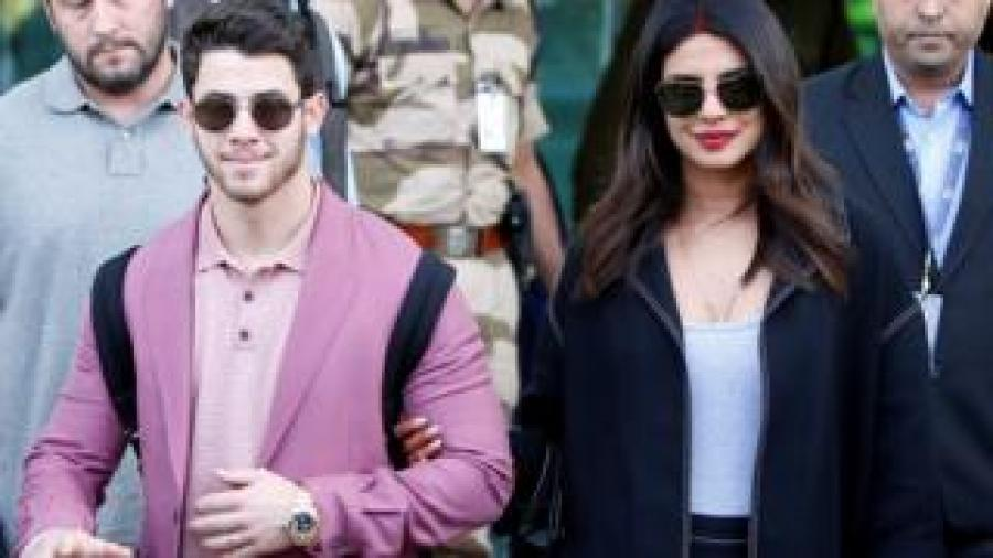 Ms Chopra (R) and Mr Jonas arrive in Udaipur