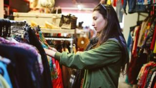 Woman in a second-hand clothes shop