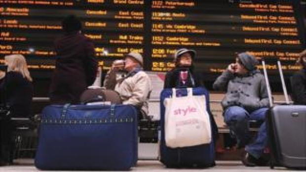 Commuters at station with trains cancelled and delayed, spring 2018