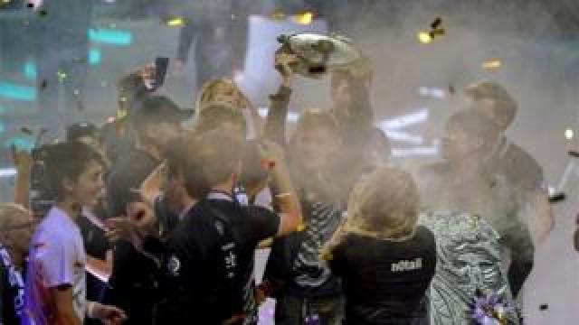 "Johan ""N0tail"" Sundstein holds trophy"