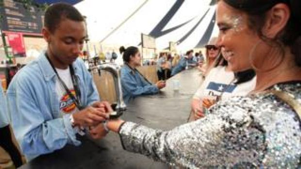Festival attendee uses a wristband to pay