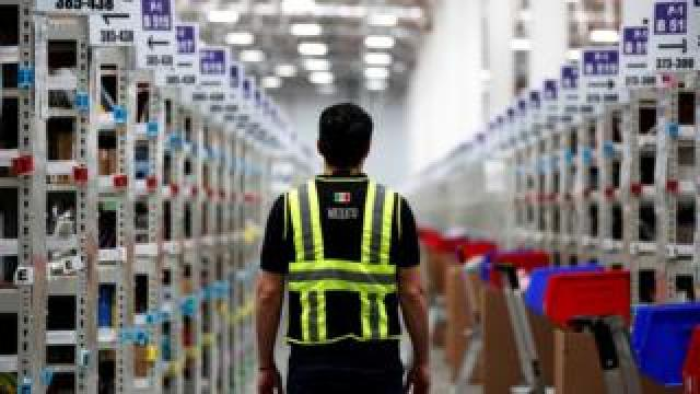 A worker in an Amazon warehouse in Mexico City, Mexico
