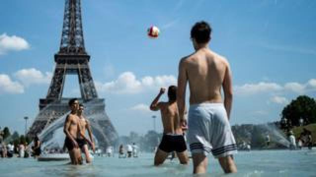 Youths playing in Trocadero fountain near Eiffel Tower, Paris, 25 June 19