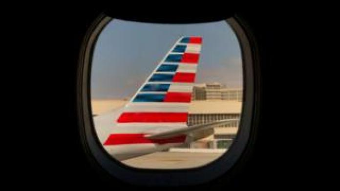 An American Airlines jet sits on the tarmac at LAX in Los Angeles, California, 4 March 2019