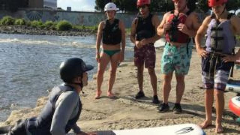 Jake Brown teaching four new surfers