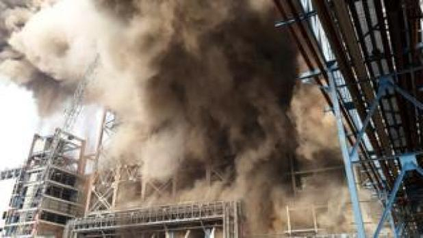 Smoke billows from a coal-fired power plant after a boiler unit exploded in the town of Unchahar in the northern Indian state of Uttar Pradesh on 1 November 2017.