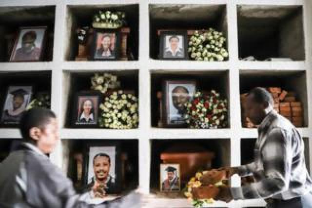Portraits of victims of the Ethiopian Airlines flight crash are displayed during a mass funeral at Holy Trinity Cathedral in Addis Ababa, Ethiopia, on 17 March 2019.