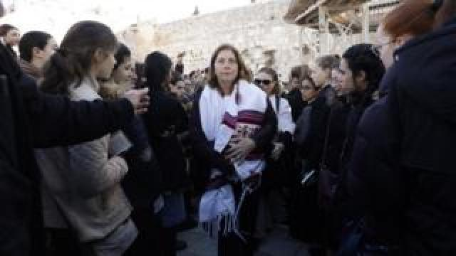 "Anat Hoffman (C), the head of the liberal Jewish religious movement ""Women of the Wall"", leaves Judaism's holiest prayer site of the Western Wall in the Old City of Jerusalem on 8 March 2019"
