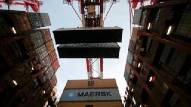 Containers are seen unloaded from the Maersk's Triple-E giant container ship Maersk Majestic at the Yangshan Deep Water Port, part of the Shanghai Free Trade Zone, in Shanghai, China (24 September 2016)