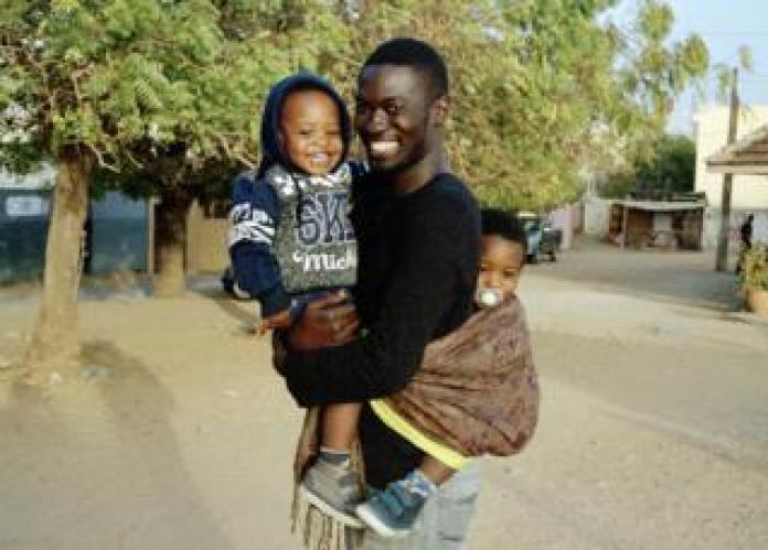 Moulaye, Hassan and Malick in Mermoz, a residential neighbourhood of Dakar, Senegal