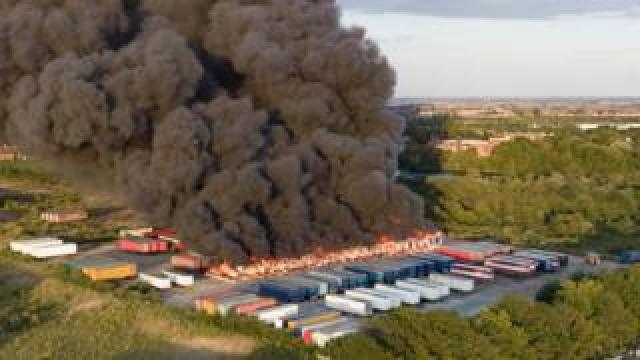 Fire engulfing several lorry trailers