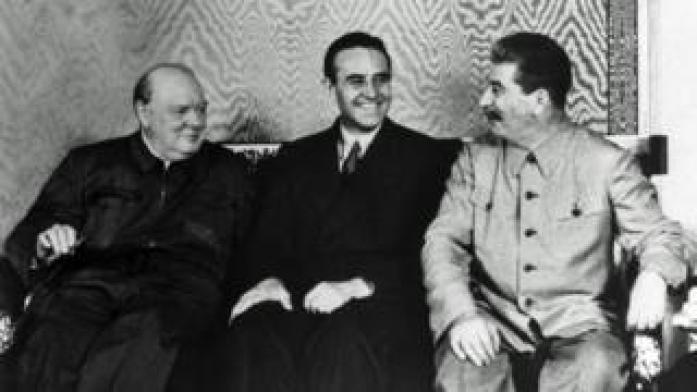 US ambassador Averell Harriman sitting between Winston Churchill and Joseph Stalin at the Kremlin