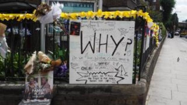 A poster asking 'Why?' near Grenfell Tower