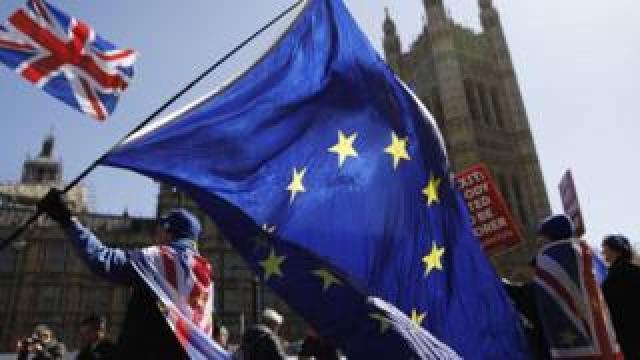 EU and Union flags outside Parliament