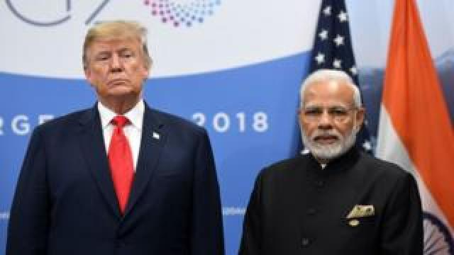 India's Prime Minister Narendra Modi (R) and US President Donald Trump