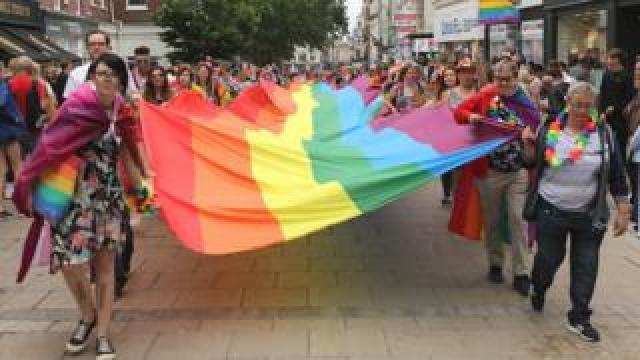 Pride flag carried through he centre of Norwich