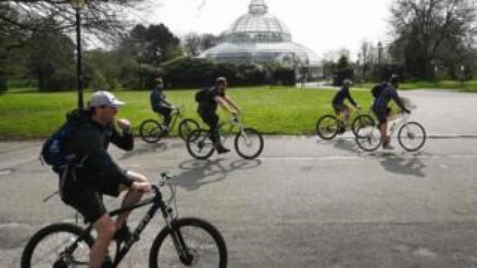 Cyclists in a park in Liverpool