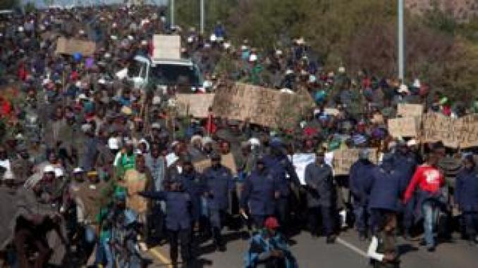 Farmers take part in a march to parliament to protest against regulations forcing them to sell their wool and mohair to a Chinese broker, in Maseru, Lesotho, on June 28, 2019. Wool and mohair are key exports for farmers in Lesotho, but the government of the small southern Africa nation signed a monopoly deal last year with a Chinese broker who is accused of failing to pay for goods. About 30,000 farmers in Lesotho, which is entirely surrounded by South Africa, rely on wool and mohair exports.