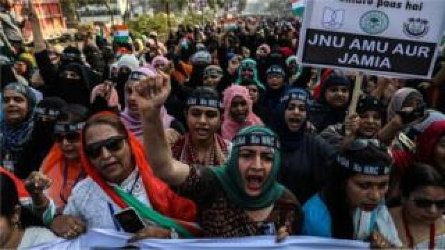 Indian Muslim women protesters shout slogans during a protest against the Citizenship Amendment Act (CAA) and National Register of Citizens (NRC), in Mumbra on the outskirts of Mumbai, India, 26 January 2020.
