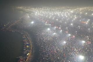 An aerial shot of pilgrims at Kumbh waiting to take a dip