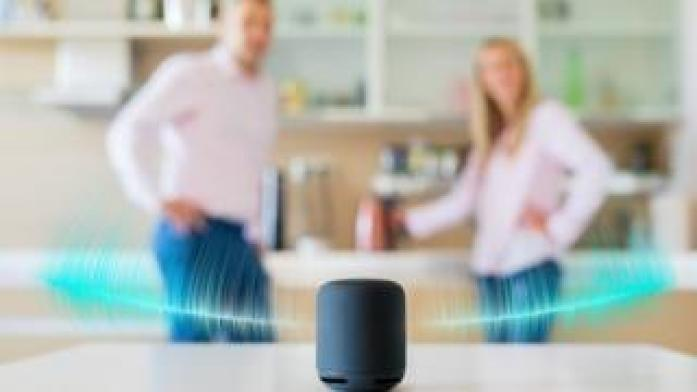 couple in kitchen with smart speaker