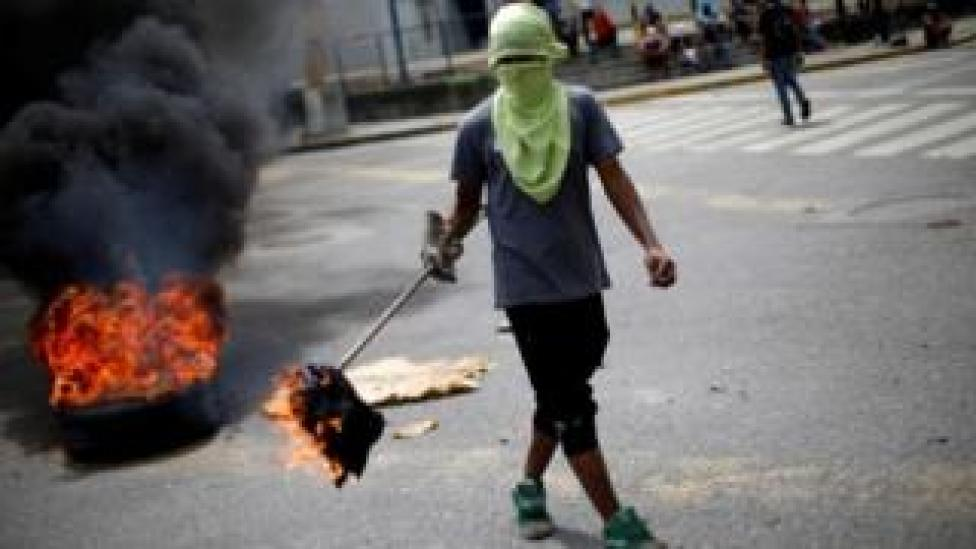 Demonstrator in Venezuela during a strike to oppose President Maduro's government, 27 July 2017