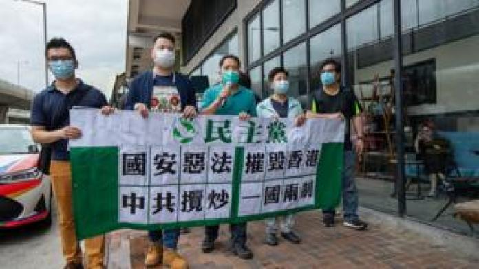 Pro-democracy lawmakers march to China's Liaison Office in Hong Kong