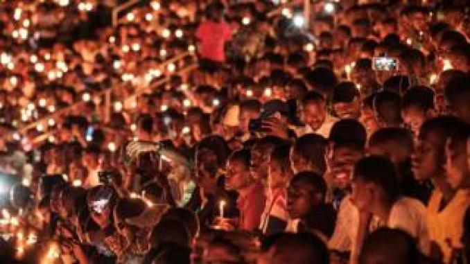 People hold candles as they attend a night vigil and prayer at the Amahoro Stadium as part of the 25th commemoration of the 1994 genocide in Kigali, Rwanda - Sunday 7 April 2019