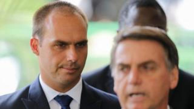 President-elect Jair Bolsonaro (R) and his son Eduardo Bolsonaro (L) are seen at the headquarters of the transitional government in Brasilia
