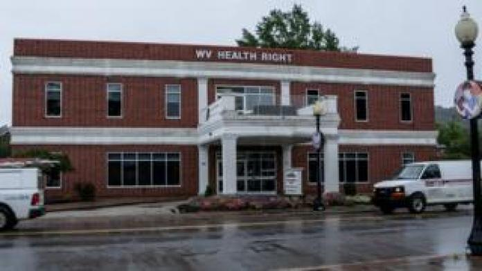 Exterior of WVHR building, red brick, white columns